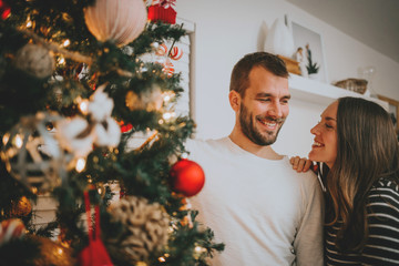 Loving Couple in front of Christmas Tree