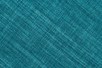 Close up of a woolen fabric of turquoise color.