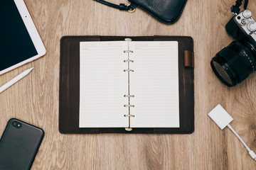 Top view of notebook ,camera ,smart phone and accessories,Travel vacation background concept.