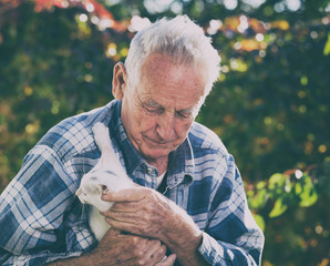 Elderly man with cat