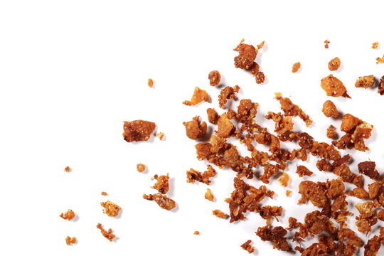 Pork cracklings isolated on white background, top view
