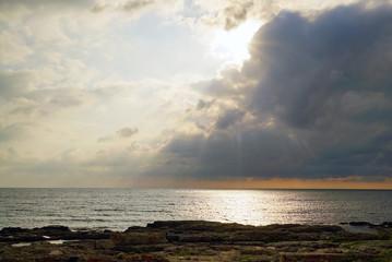 The sun breaks through the clouds above the sea . Tarhankut. Crimea