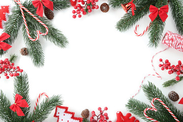 Christmas decorations with fir tree branches on white background