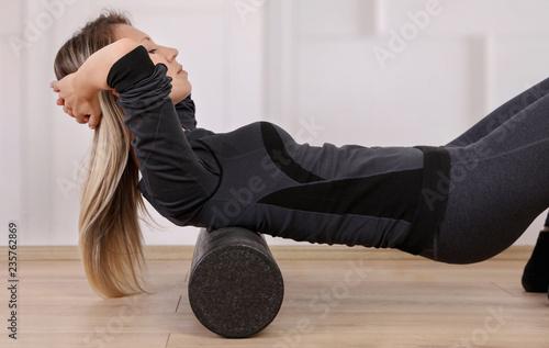 Mindful workout holistic health care  Woman doing foam