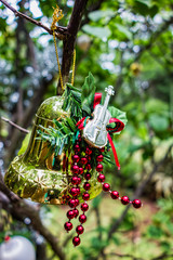 Christmas ornament with bell and guitar on tree in the garden