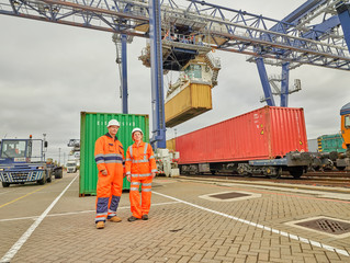Dock workers by railway tracks at Port of Felixstowe, England