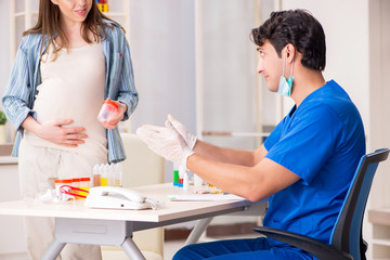 Pregnant woman visiting doctor for check-up
