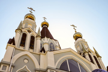 Russian Orthodox Church towers with three domes and crosses