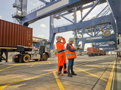 Dock workers using tablet PC at Port of Felixstowe, England