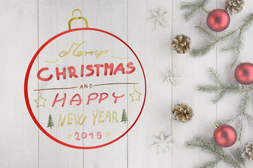 Christmas decorations, pine cones and red balls on a white wooden table. Hand-drawn font. Included Merry Christmas and happy new year 2019 text