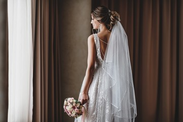 Gorgeous bride in a beautiful dress. Morning newlyweds.