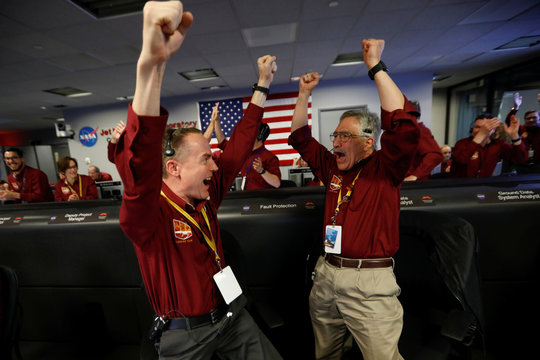 NASA engineers Kris Bruvold and Sandy Krasner react in the space flight operation facility at NASA's JPL as the spaceship InSight lands on the surface of Mars after a six-month journey, in Pasadena