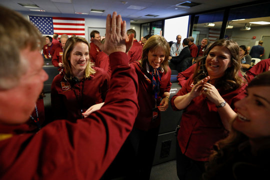 Female engineers from NASA celebrate in the space flight operation facility at NASA's Jet Propulsion Laboratory (JPL) after the spaceship InSight landed on the surface of Mars, from Pasadena, California