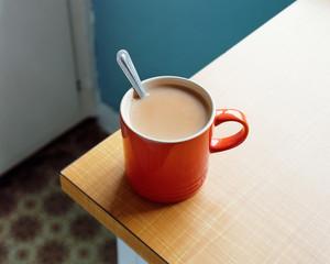 Red tea mug with spoon