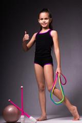 Teenager girl involved in rhythmic gymnastics. Black background