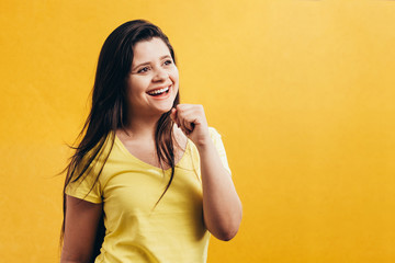 Woman singing isolated on color background. Happy woman singing with imaginary microphone