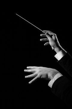 Conductor's hand holding baton