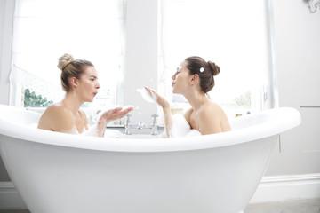 Young women in bubble bath