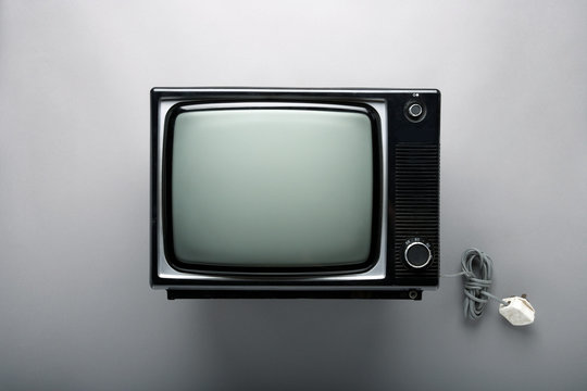 Television on gray wall