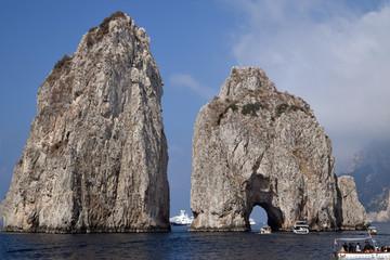 up close view of Faraglioni from boat trip. Capri, Italy
