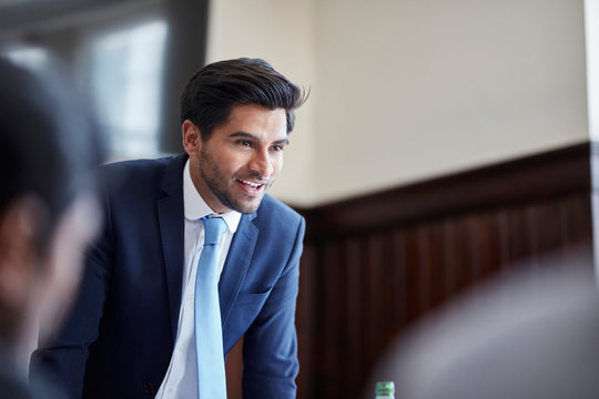 Businessman speaking at meeting