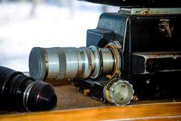 Old movie camera behind the window.