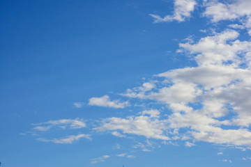 blue sky with clouds on the right background