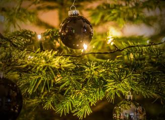 Christmas background of de-focused lights decorated tree illuminated moody