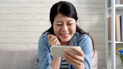 housewife using mobile phone smiling on talk show
