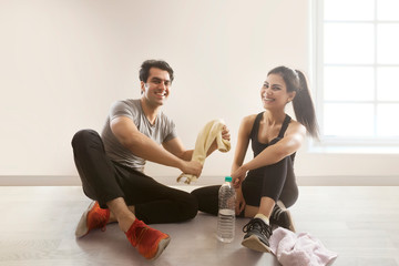 Young couple relaxing after workout