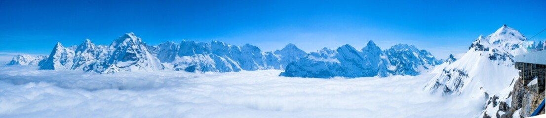 Stunning Panoramic view of snow mountain the Swiss Skyline from Schilthorn, Switzerland Wall mural