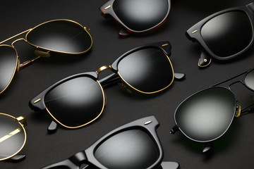 Old-fashioned sunglasses on black background Wall mural