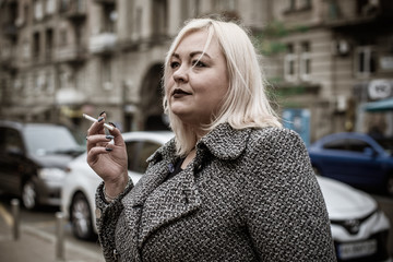 Problem of smoking, plump woman with a cigarette