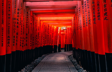 Red Torii gates in Fushimi Inari shrine, one of famous landmarks in Kyoto, Japan