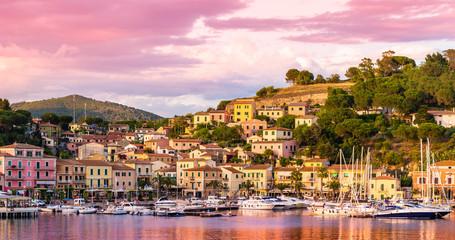 Wall Mural - Harbor and village  Porto Azzurro at sunset, Elba islands, Tuscany, Italy