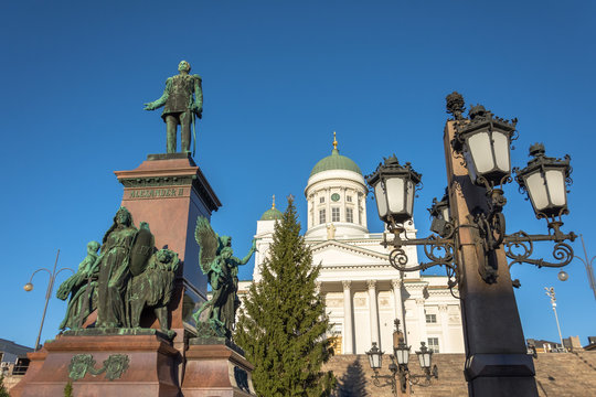 Helsinki Cathedral with a monument to Alexander II and streetlights.