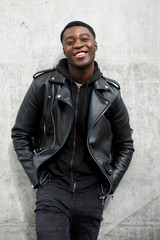 smiling young black man in leather jacket