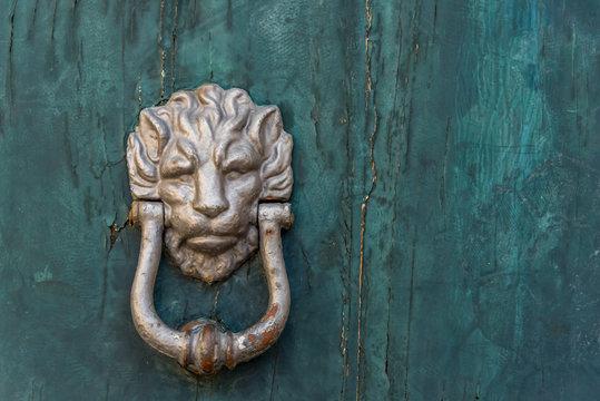 Ancient Lion Door Knocker on a Door in an Italian Village