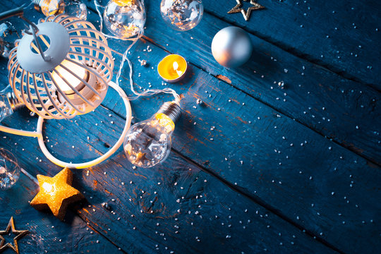 Christmas lantern with decoration on blue background