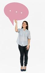Cheerful woman holding a speech bubble symbol