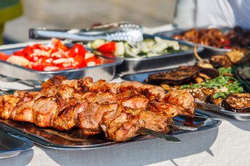 Shish kebab and other street food on a table
