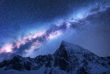 Milky Way above snowy mountains. Space. Fantastic view with snow covered rocks and starry sky at night in Nepal. Mountain ridge and sky with stars in Himalayas. Landscape with bright milky way. Galaxy Fototapete