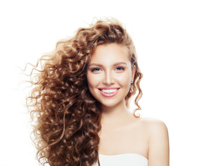 Happy smiling girl with healthy skin and perfect wavy hair isolated on white