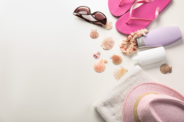 Set of beach items with seashells on white background