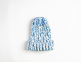 Light Blue knitted wool hat isolated on white background. Cold winter ski cap flat lay. woolen garment concept.