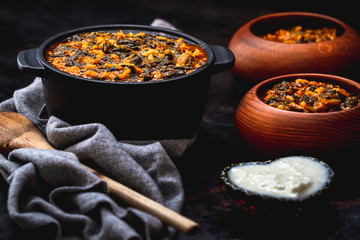 Spinach Stew with Rice in Black Pot