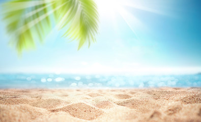 Abstract blur defocused background, nature of tropical summer beach with rays of sun light. Golden...