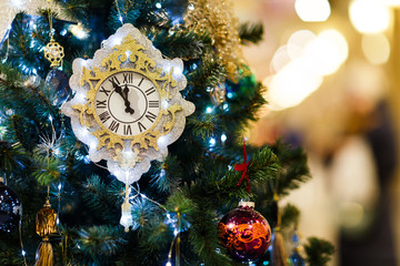 Image of decorated Christmas tree with clock, blue balls in store