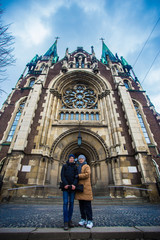 Happy family walk near old gothic church. Having great vacation in old city