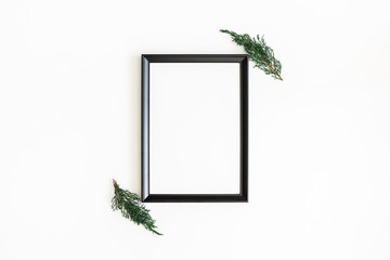 Christmas composition. Photo frame, fir tree branches on white background. Christmas, winter, new year concept. Flat lay, top view, copy space